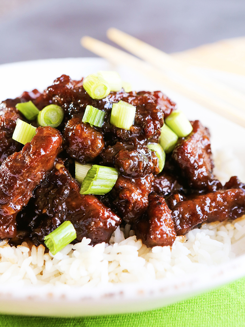 Plate of Mongolian Beef atop a bed of rice