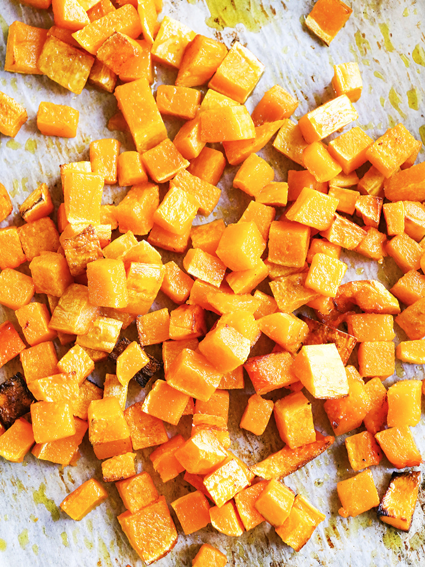 Looking down into a pan of roasted squash pieces