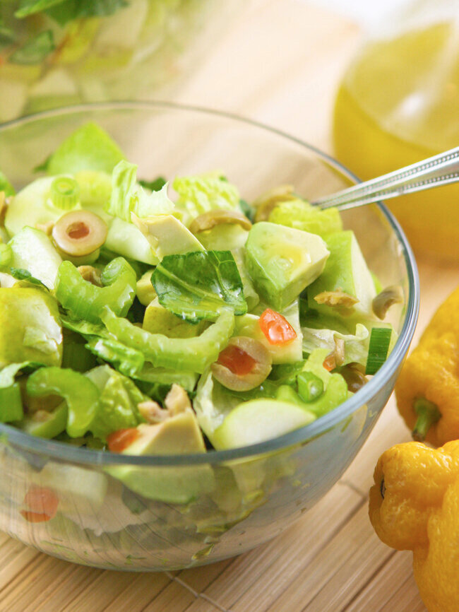 Bowl of green salad close up with fork
