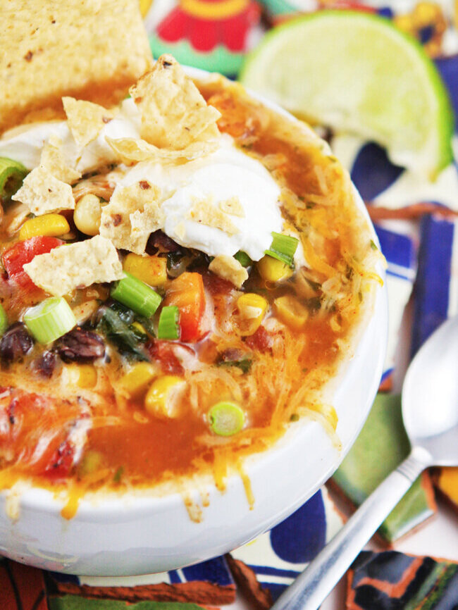 Bowl of taco soup with tortilla chips and sour cream