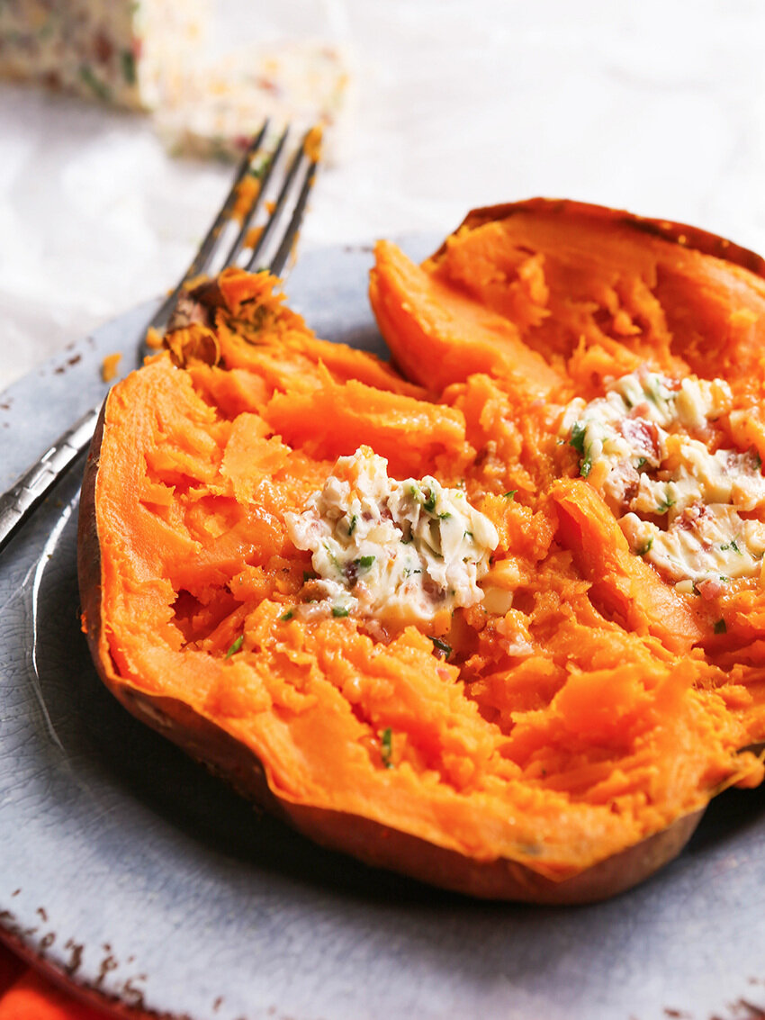 Sweet potato with bacon chive butter melted inside