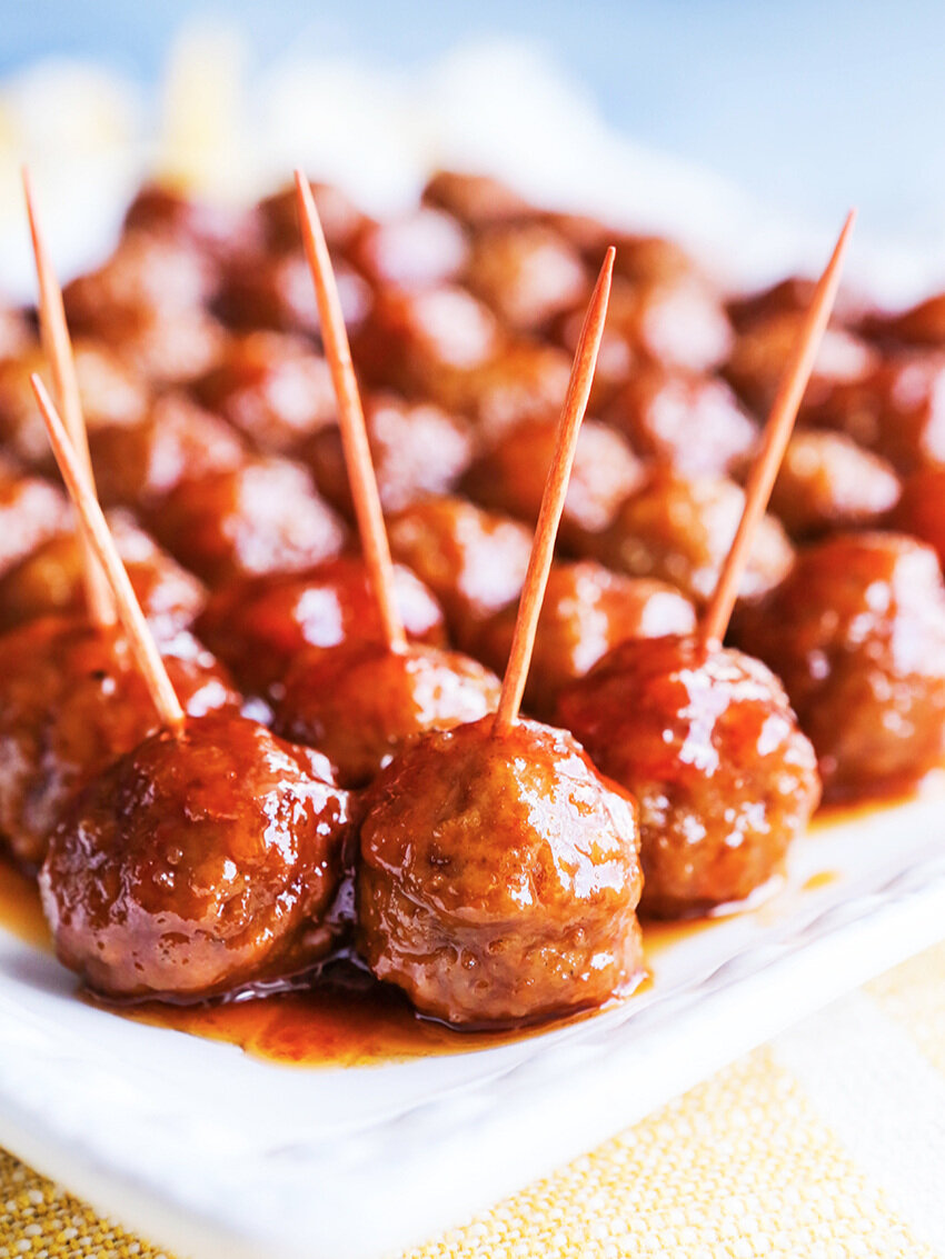 Serving platter filled with meatballs with toothpicks jabbed into them