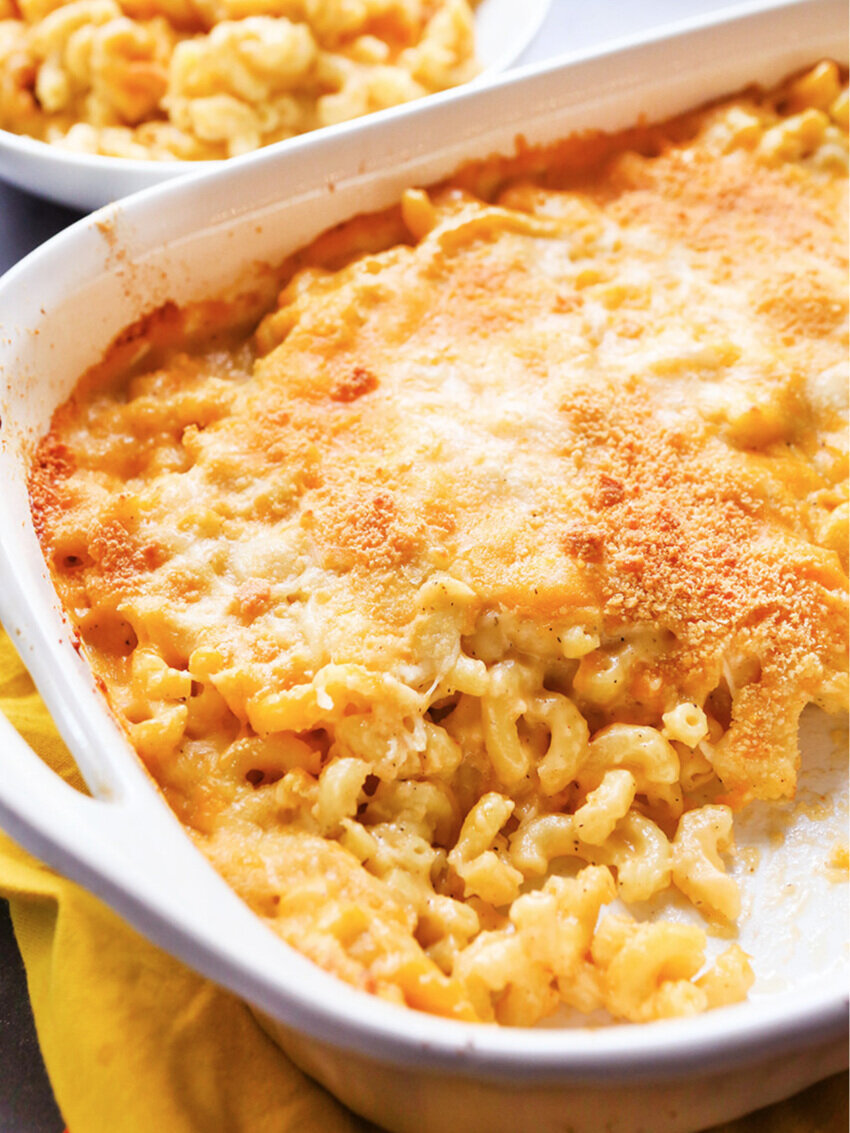 Pan of baked mac and cheese with bowl in background