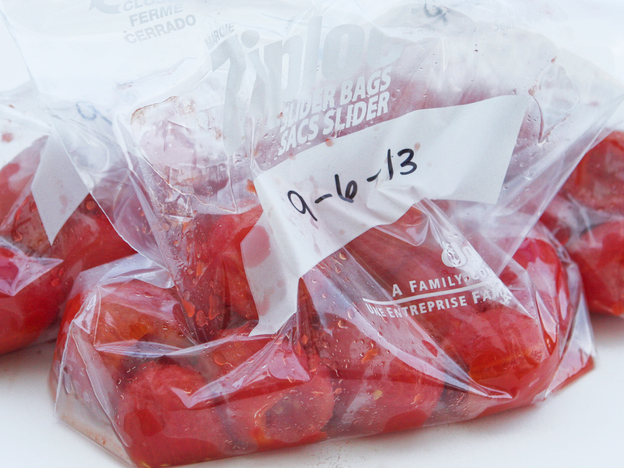 Roma tomatoes in ziploc bags ready for freezing