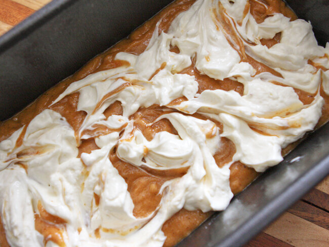 Cream cheese swirled over batter in loaf pan