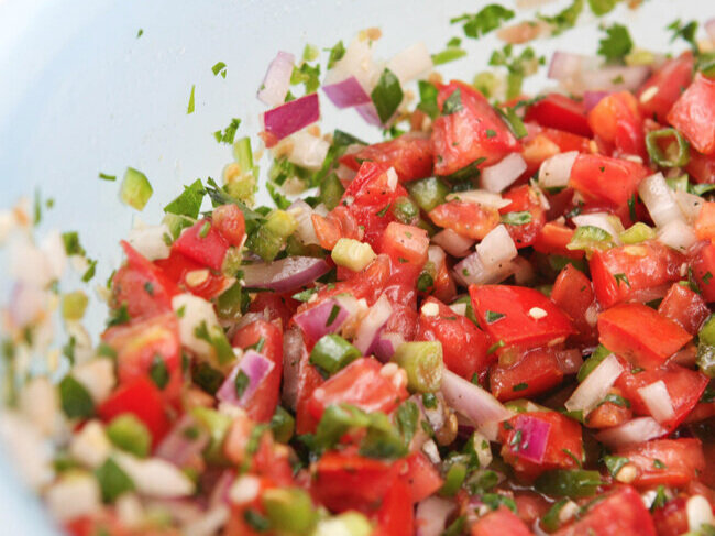 Mixing bowl filled with fresh salsa