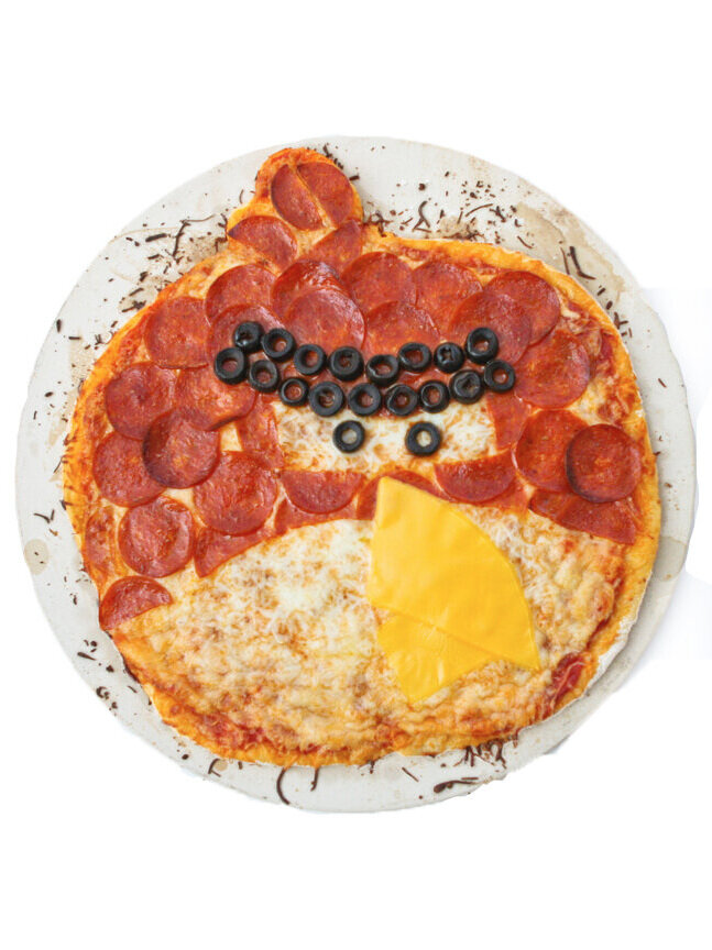 Angry Birds pizza sitting on a pizza stone