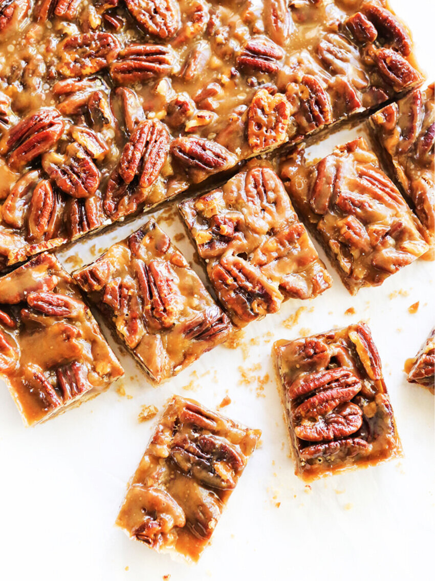 Top view of caramel pecan bars cut into squares