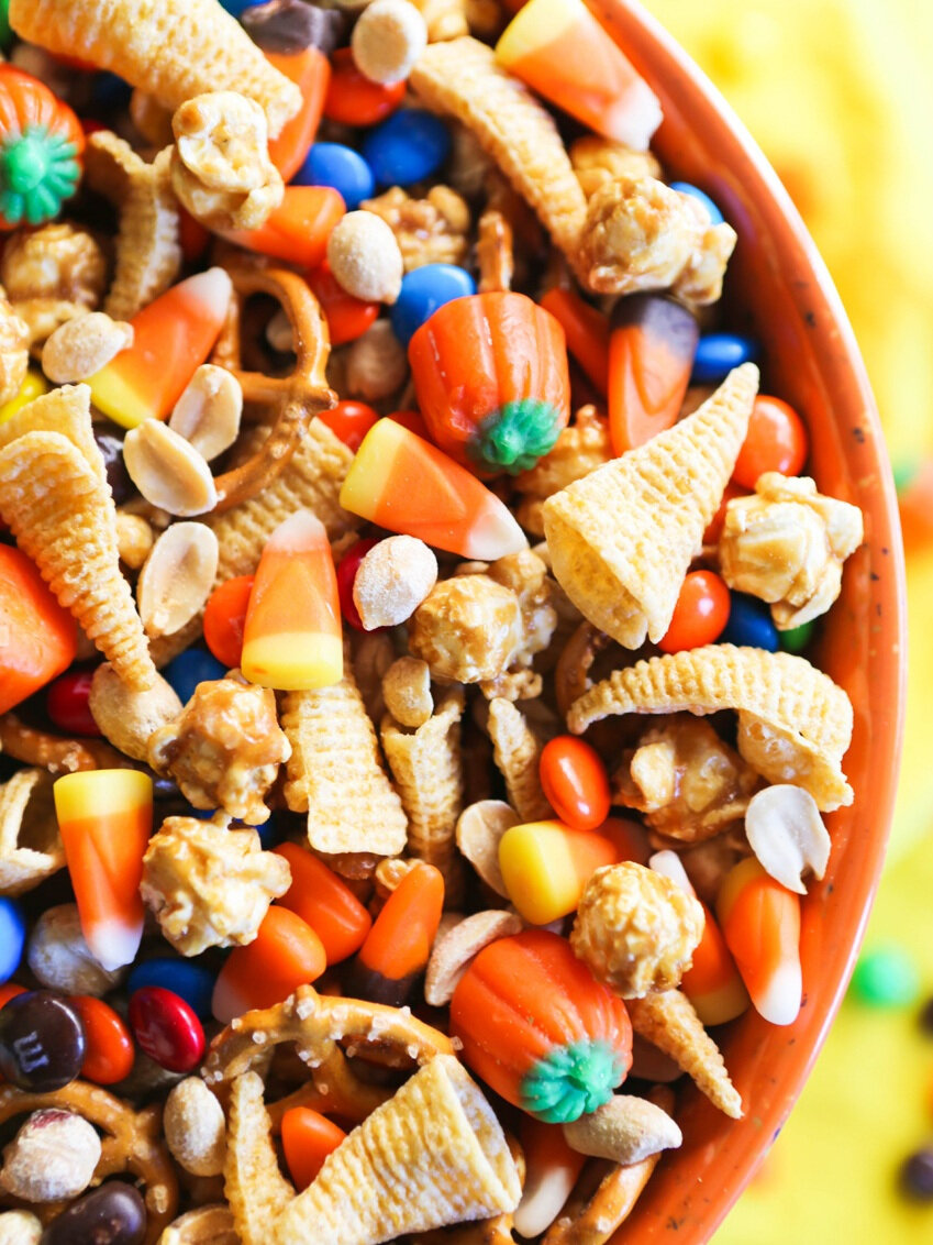 close of halloween snack mix in orange mixing bowl
