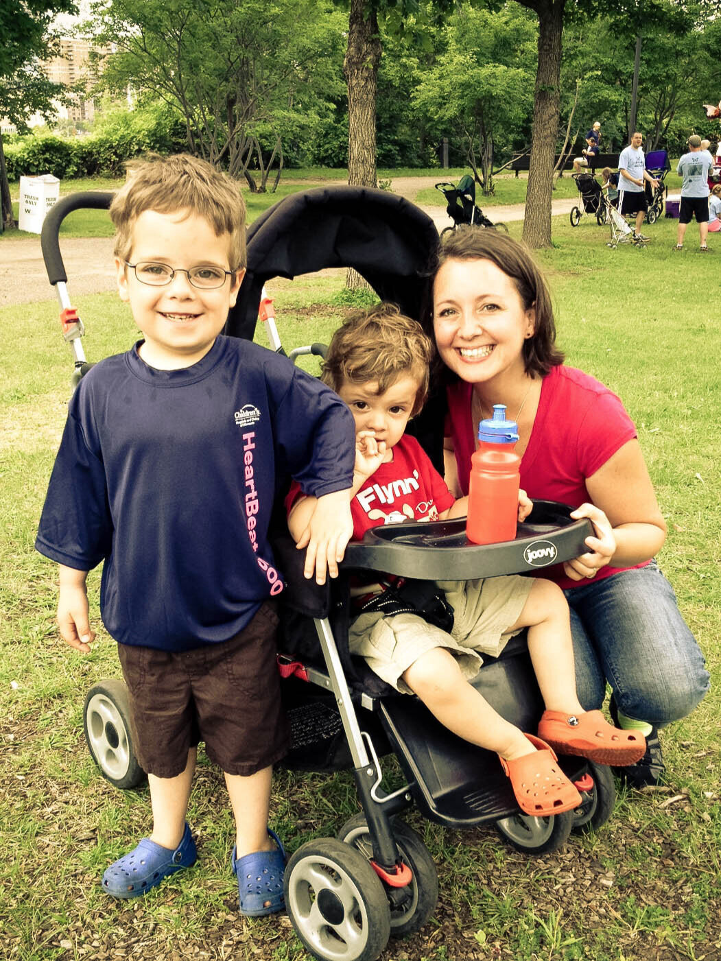 mom and boys next to stroller after heart walk