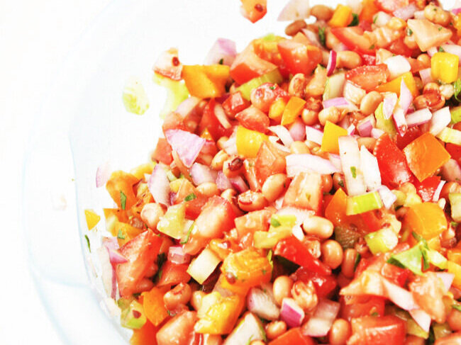 Mixed black eye pea salad in mixing bowl