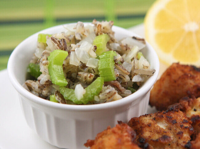 wild rice salad in a bowl next to fried walleye