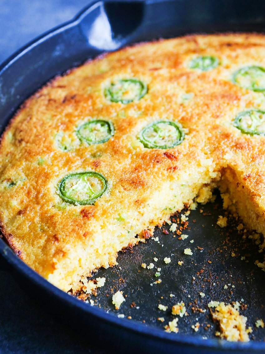 cast iron skillet with one slice cut out of cornbread recipe without buttermilk