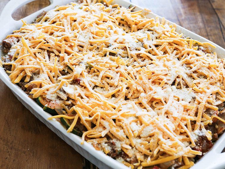 baked spaghetti ingredients layered in baking dish ready for baking