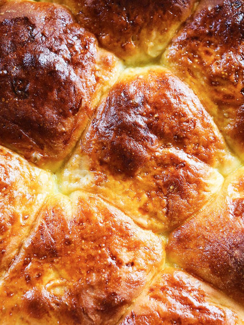 top view of baked dinner rolls in pan