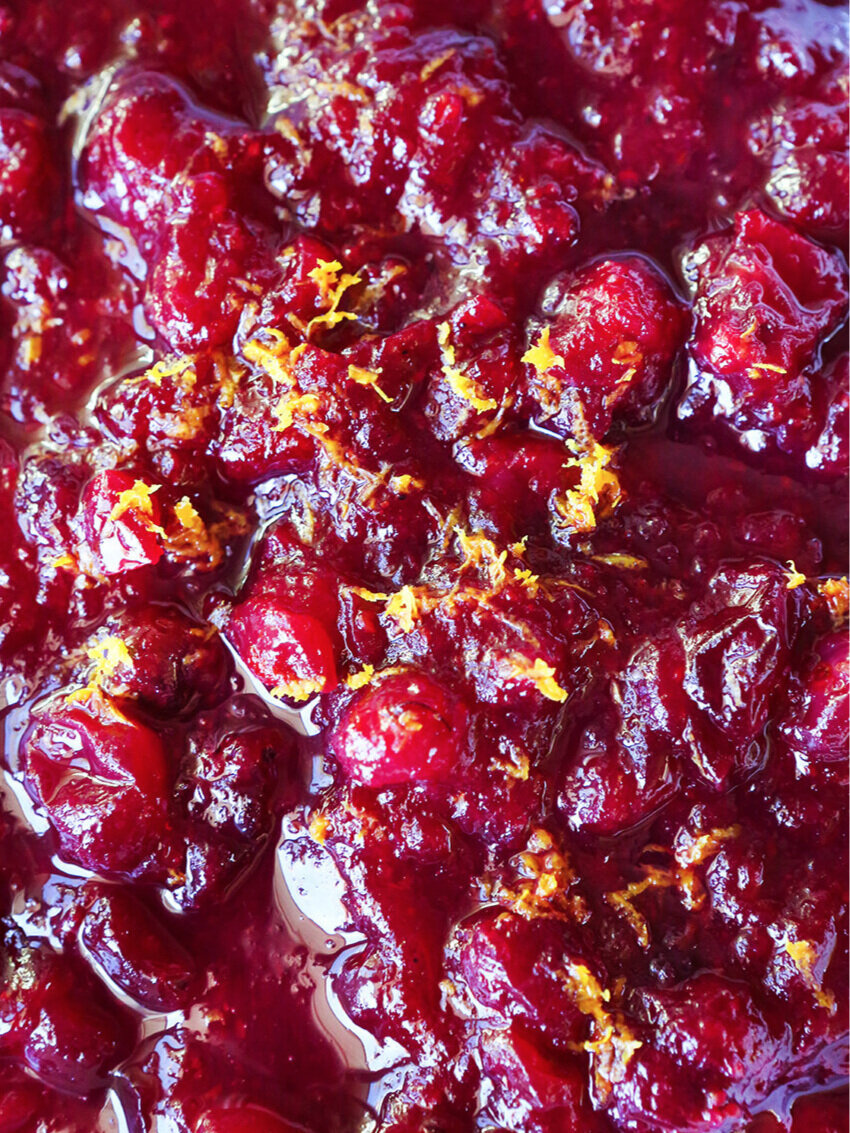 super close up of cranberry sauce with orange zest