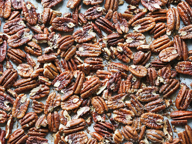 Toasted pecans on baking sheet in a single layer