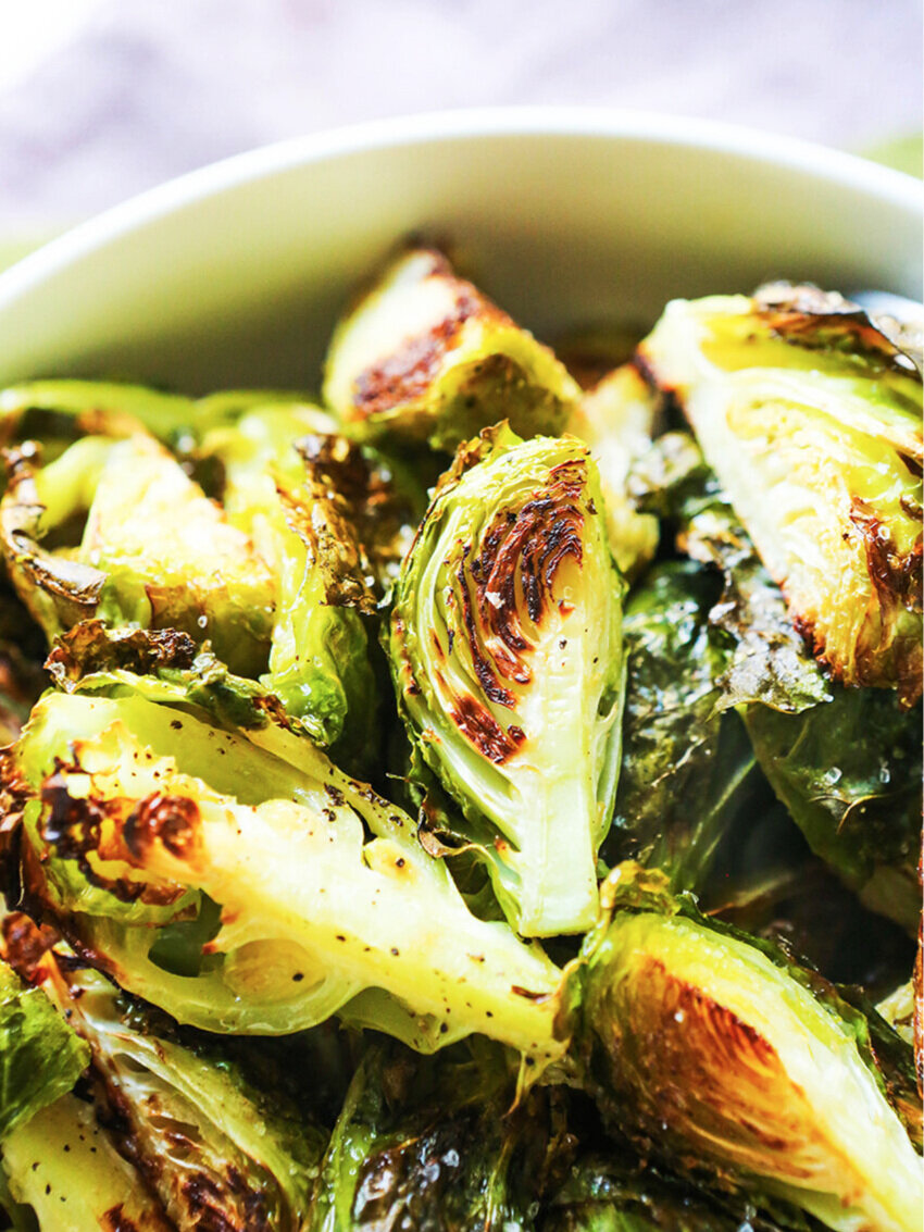 close up of roasted brussels sprouts stacked in a bowl