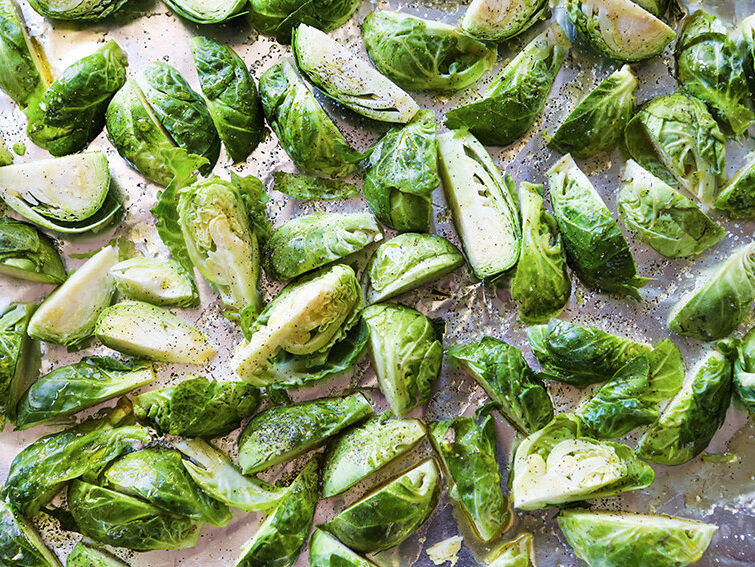 Brussels sprouts in a single layer on baking sheet ready for baking