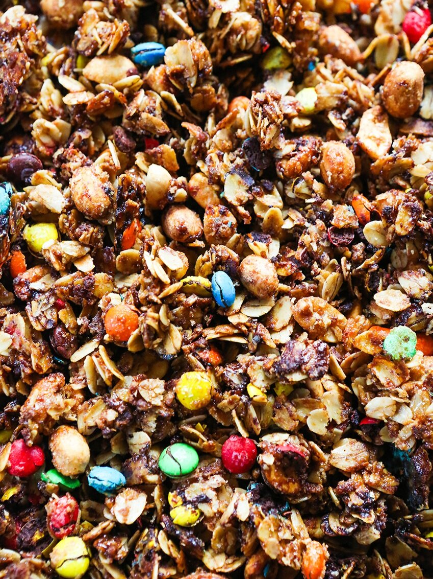 close up top view of granola with candy