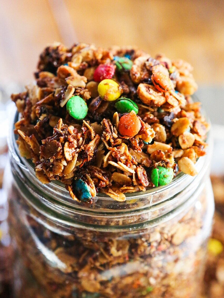 candy granola spilling out of a large mason jar