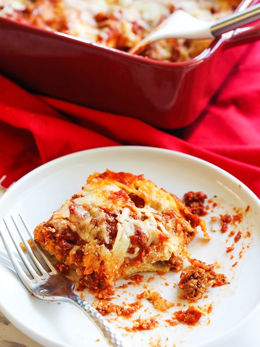 Plate of lasagna with pan beside it