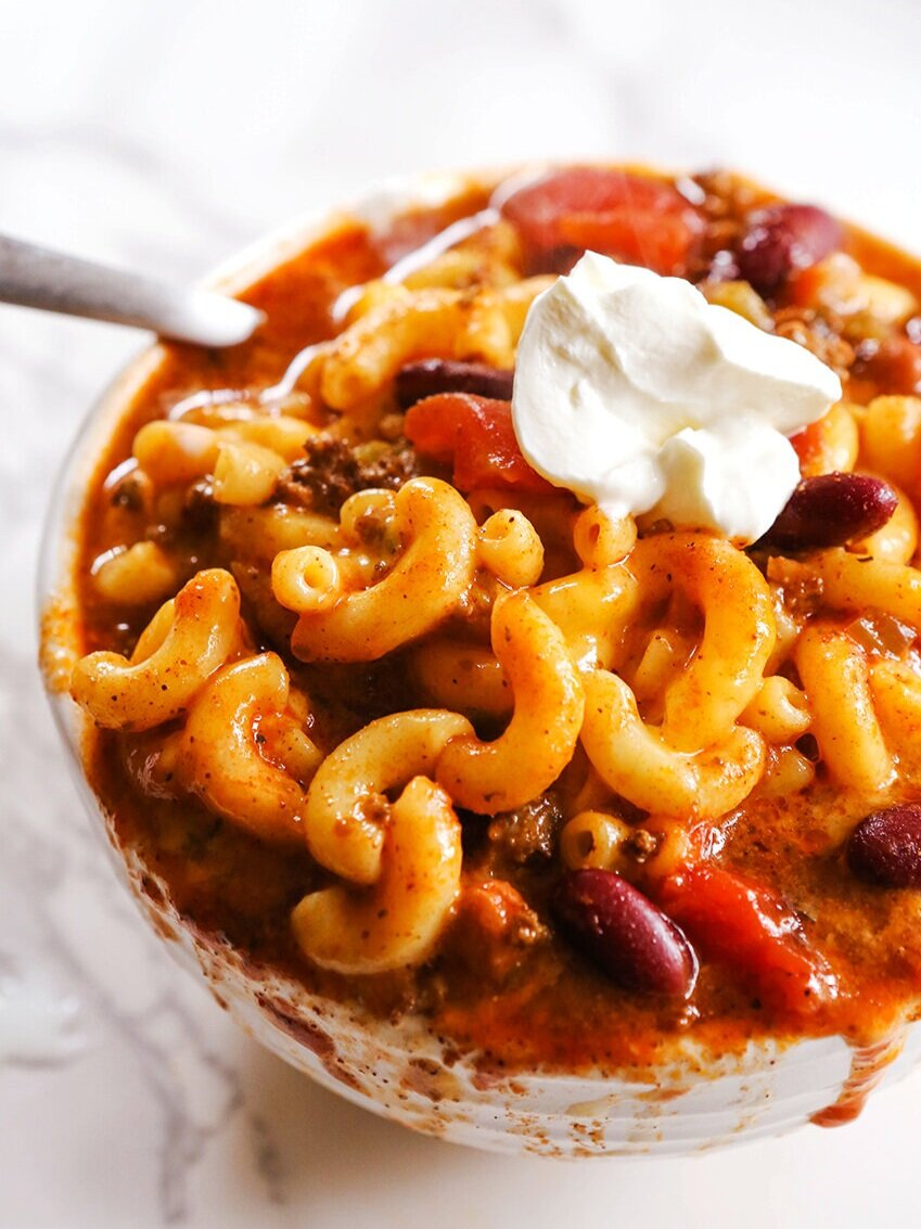 Bowl of chili mac with a dollop of sour cream on top