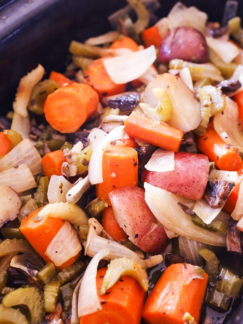 cooked carrots, celery, onions and potatoes in a crockpot