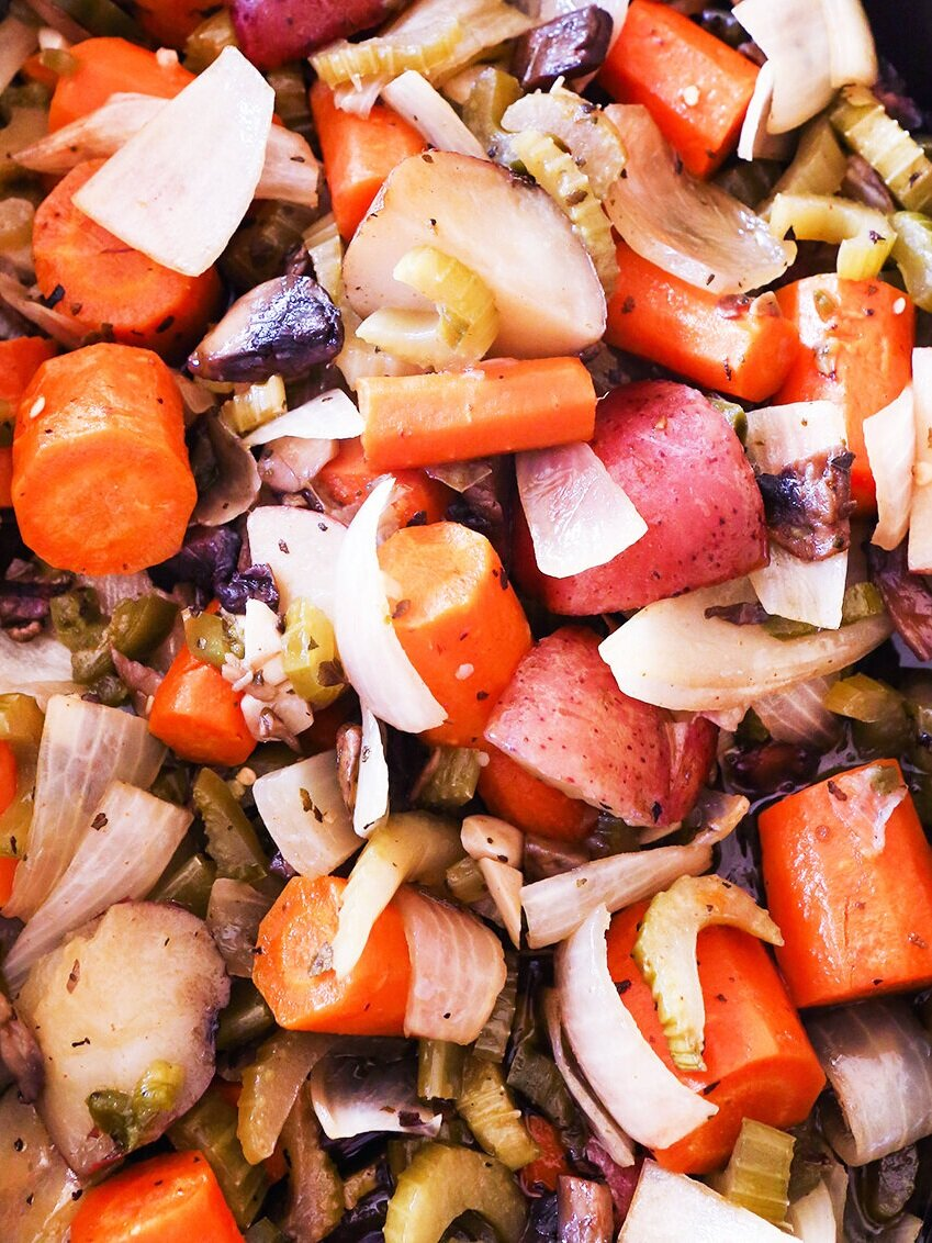 close up top view of cooked veggies in a crock pot