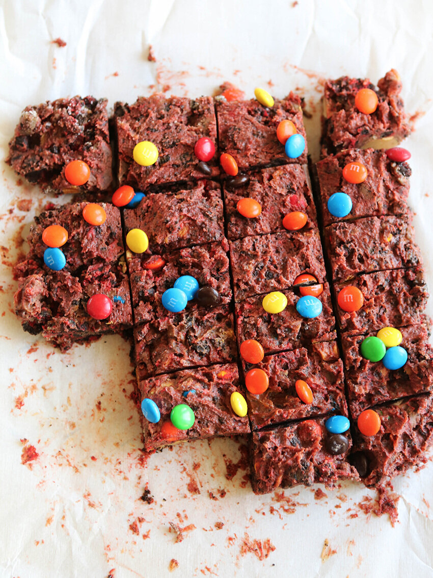 top view of sliced dessert bars with M&M's on top
