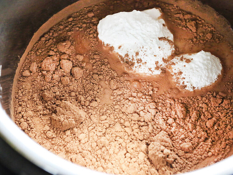 Hot chocolate ingredients in Instant Pot ready for cooking
