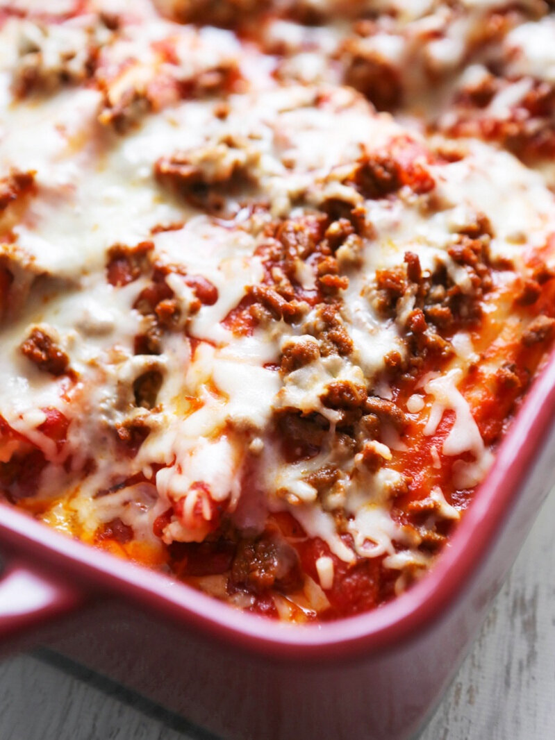 Baked dish of meat and cheese manicotti recipe just out of the oven