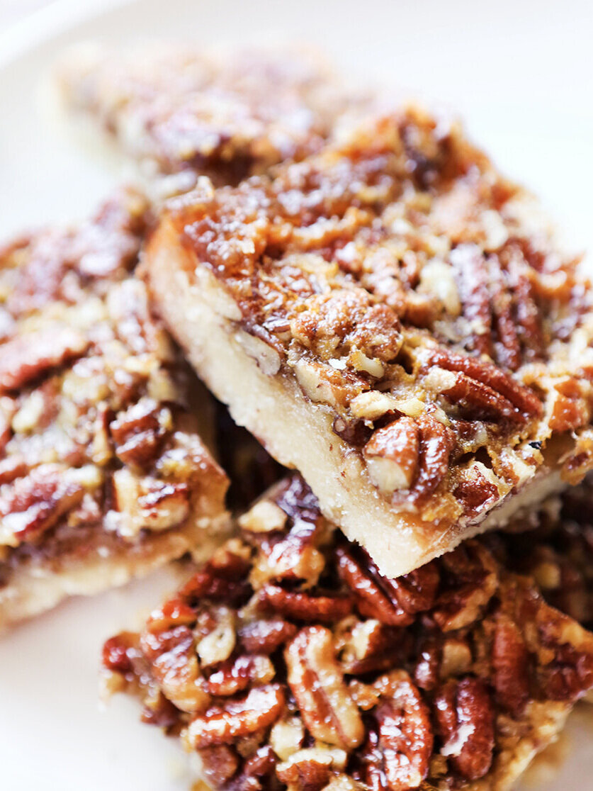close up of a stack of pecan pie bars