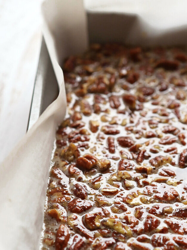 pecan pie bars filling poured into pan ready to bake