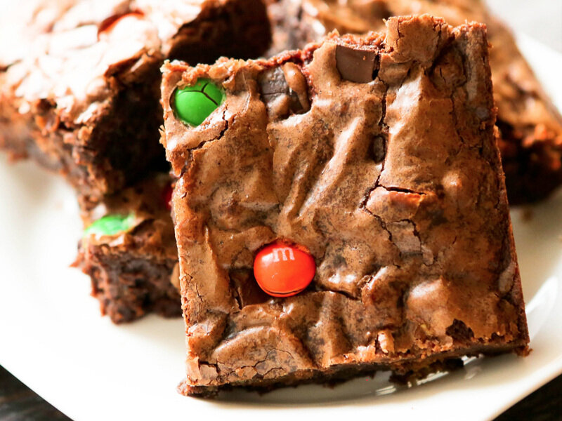 Candy bar brownie propped up against a few others