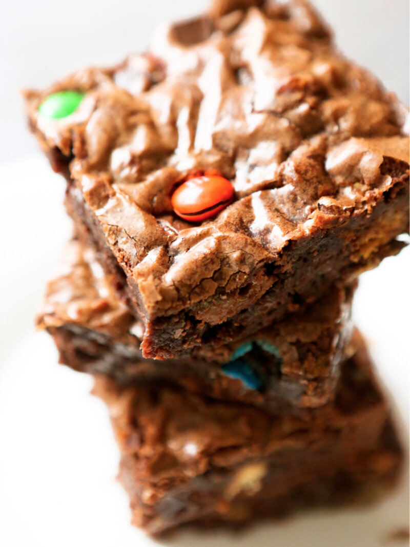 Tall stack of candy bar brownies with focus on top one