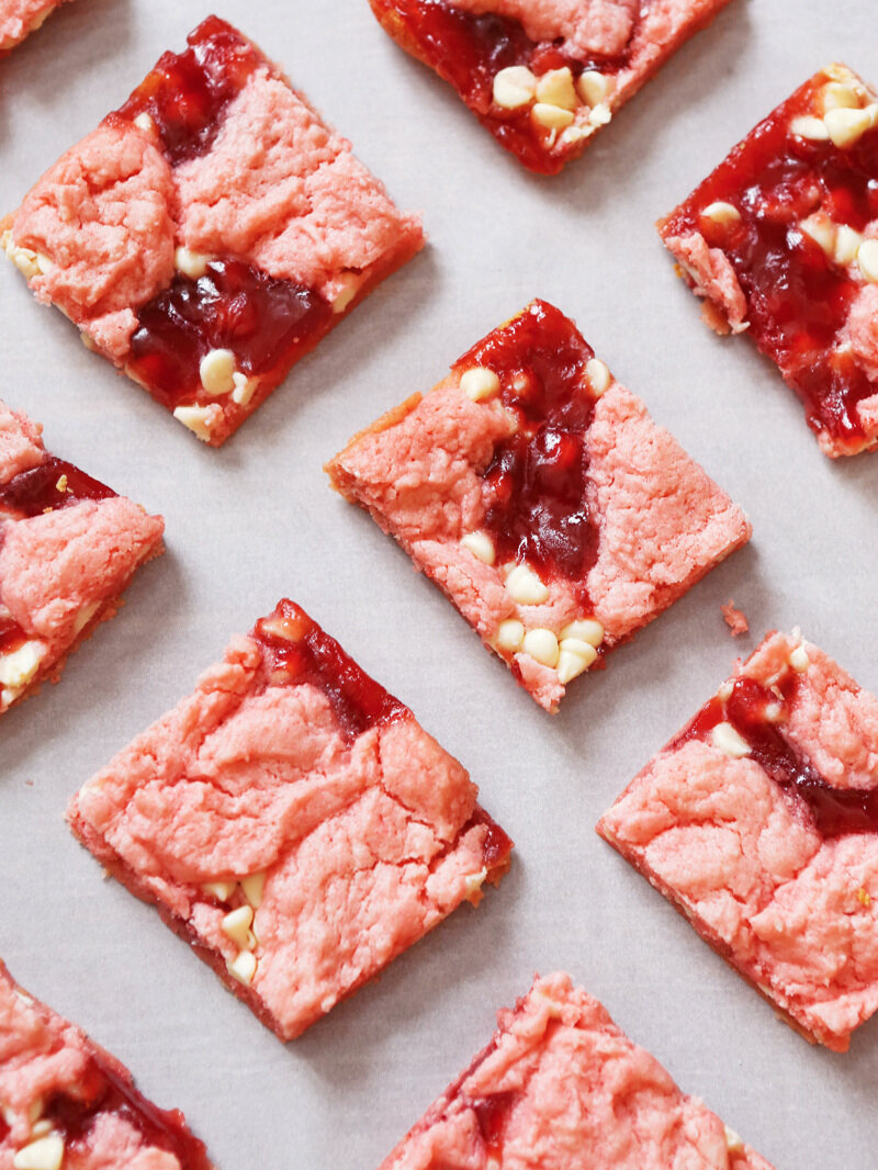 top view of strawberry brownies lined up on parchment