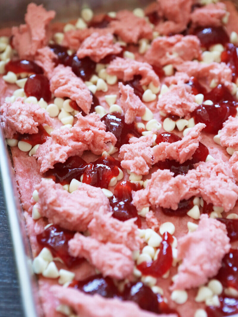 strawberry brownies assembled in pan before baking