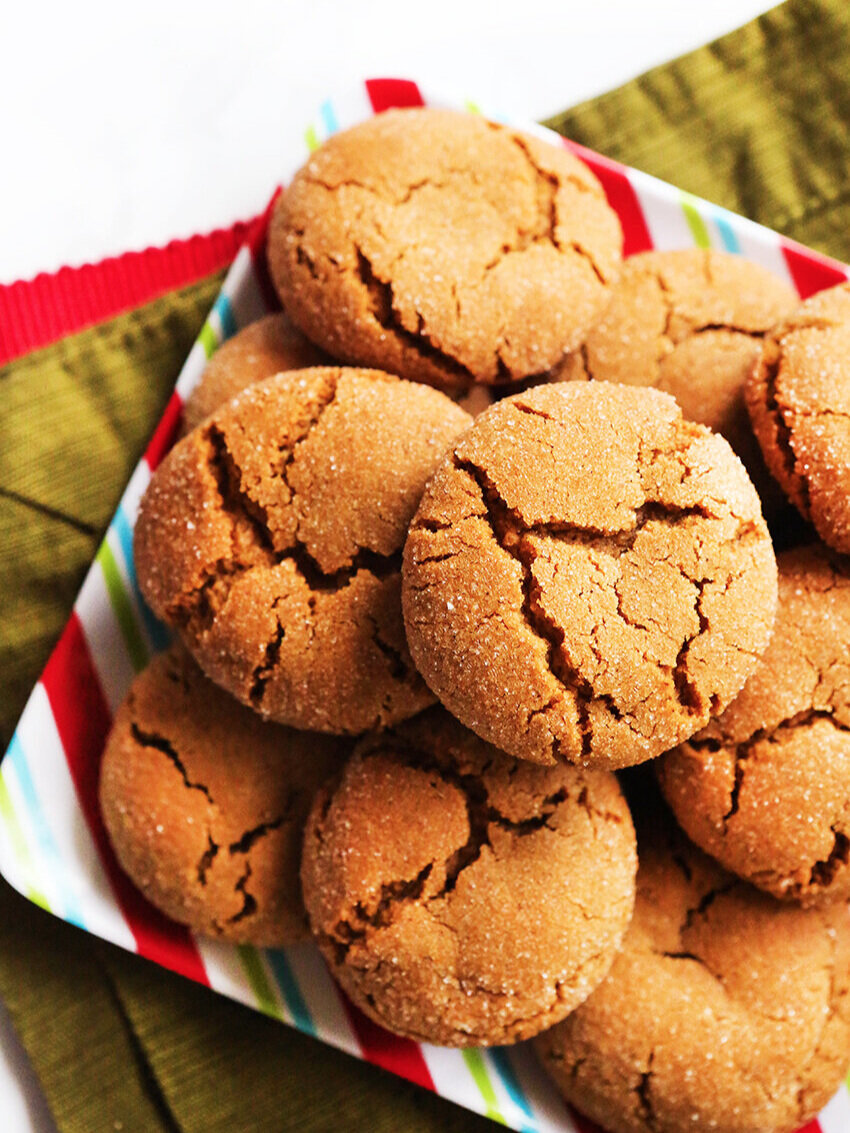 festive plate with molasses cookies stacked on it