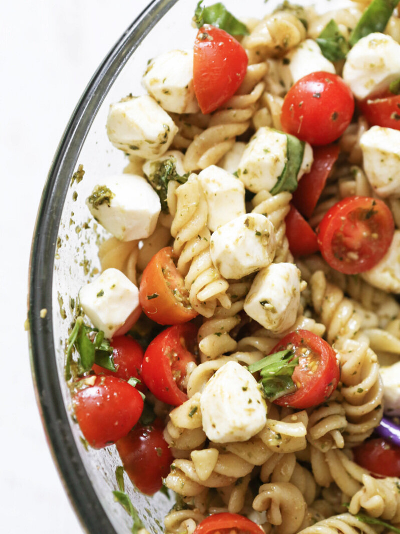 close up of bowl of caprese pasta salad