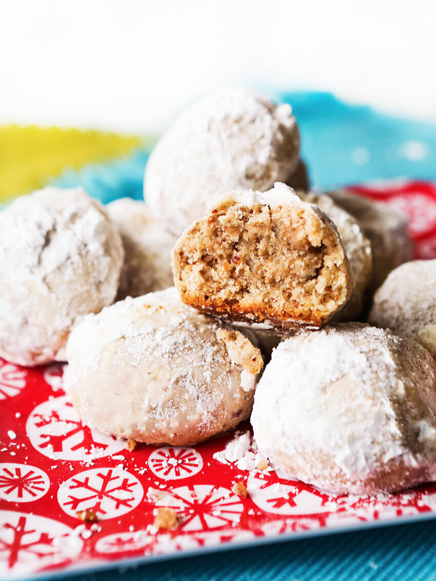 Stack of pecan balls on a festive plate