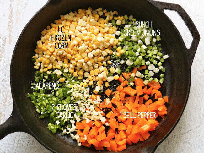 Ingredients in cast iron skillet for hot corn and crab dip