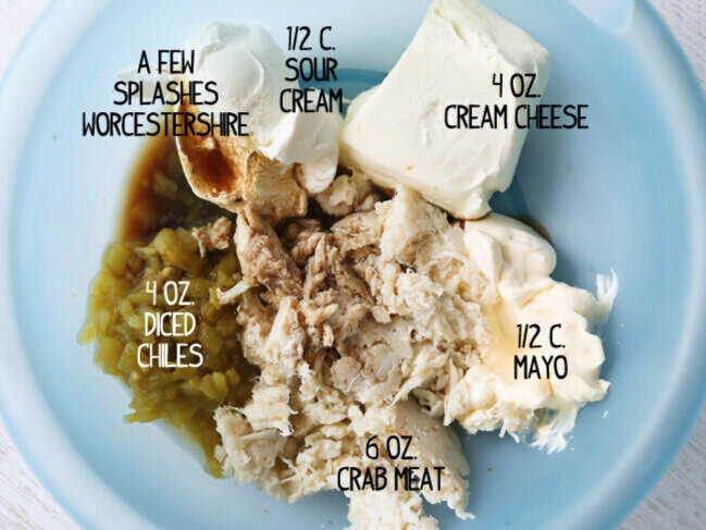 crab meat along with other ingredients in mixing bowl
