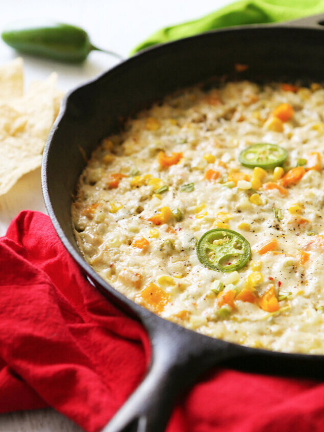 Hot corn and crab dip in skillet ready to serve