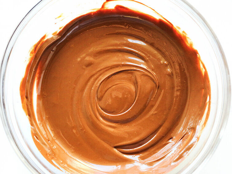 creamy melted chocolate in mixing bowl