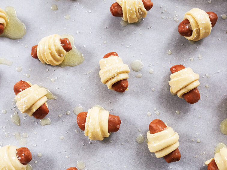 pigs in a blanket on baking sheet ready for baking