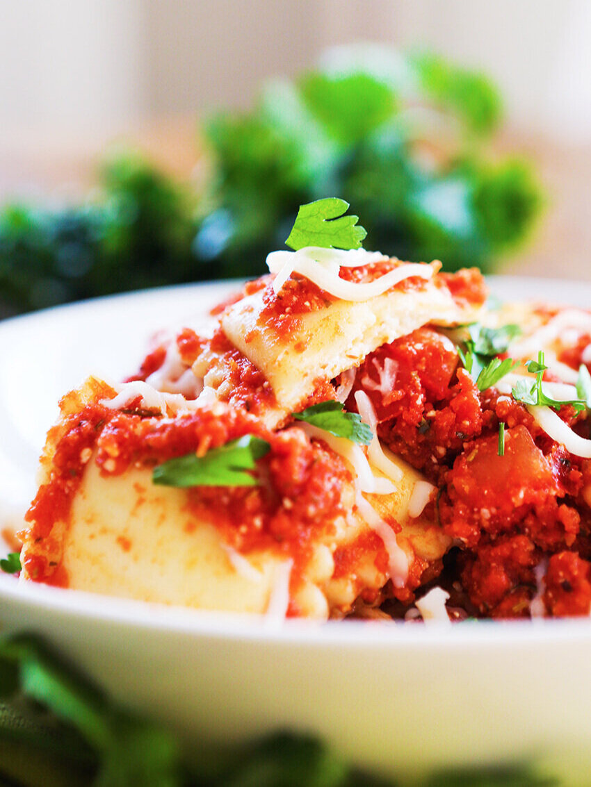 Heaping bowl of cheese ravioli with parsley