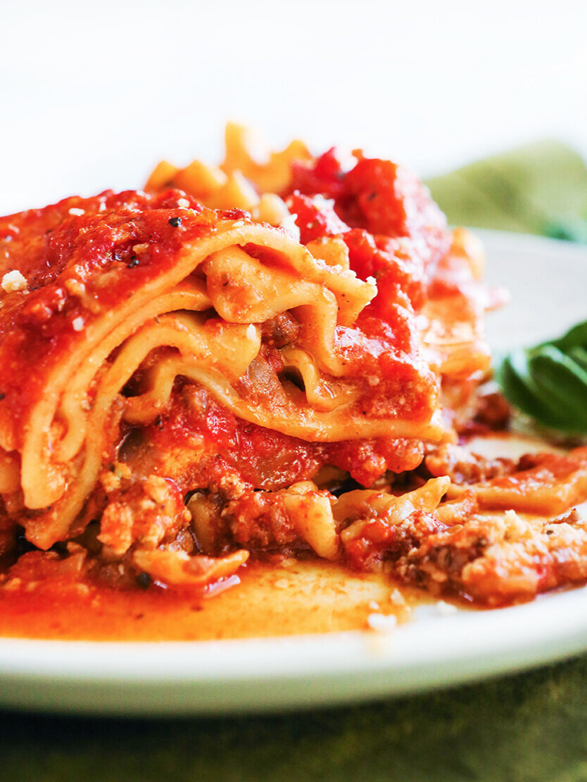 Close up of side of piece of lasagna showing the layers