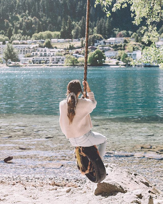 I asked @jort_ what I should caption this photo and we've now been singing every song that has anything to do with a swing for a good twenty minutes. 🤦🏻‍♀️ so enjoy this photo of me sitting on a swing staring at Queenstown while we sing All American Rejects. #swingswing #townertravels #nzmustdo