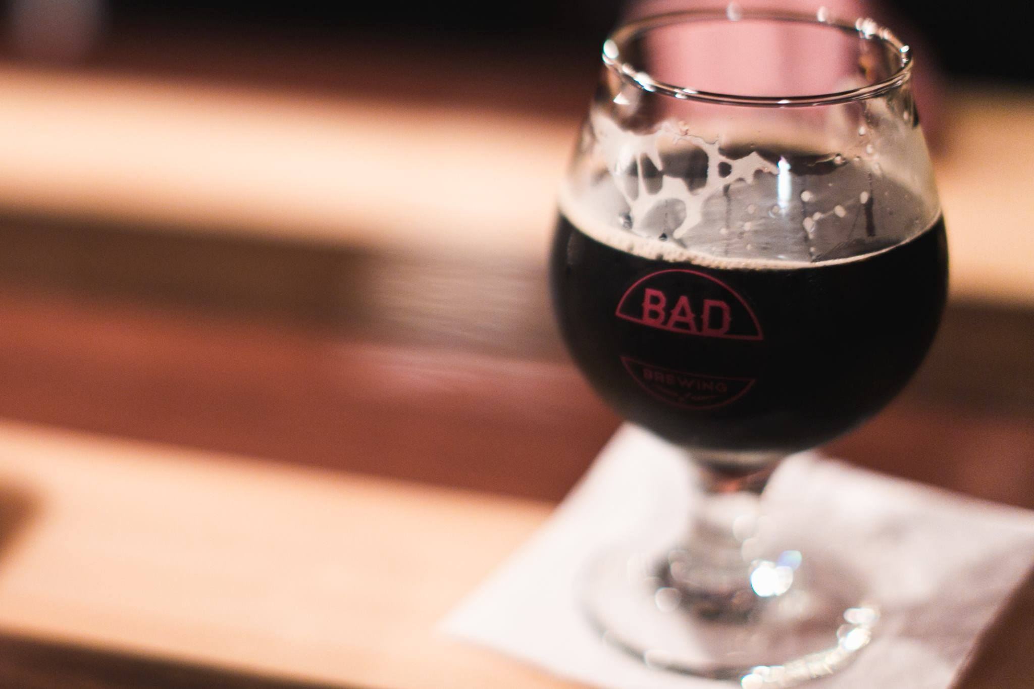 Dark Addiction       5.2% ABV  37 IBU   Spring, Summer, Fall or Winter. Don't miss out on this intensely roasted, silky smooth chocolatey goodness known as Dark Addiction. This beer pours dark as night with a nice tan frothy head and a creaminess from the added lactose milk sugars. Rumor has it that chocolate milk is great for recovering proteins and nutrients after a hard work out, once you try Dark Addiction you may consider this your go to drink after that 5K you struggle through this year.